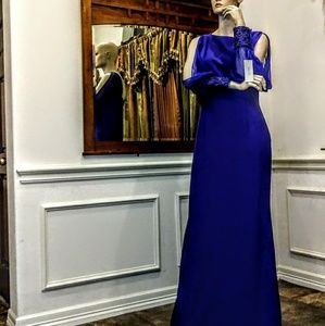 Teri Jon long gown by Freeman.  Long sleeves.